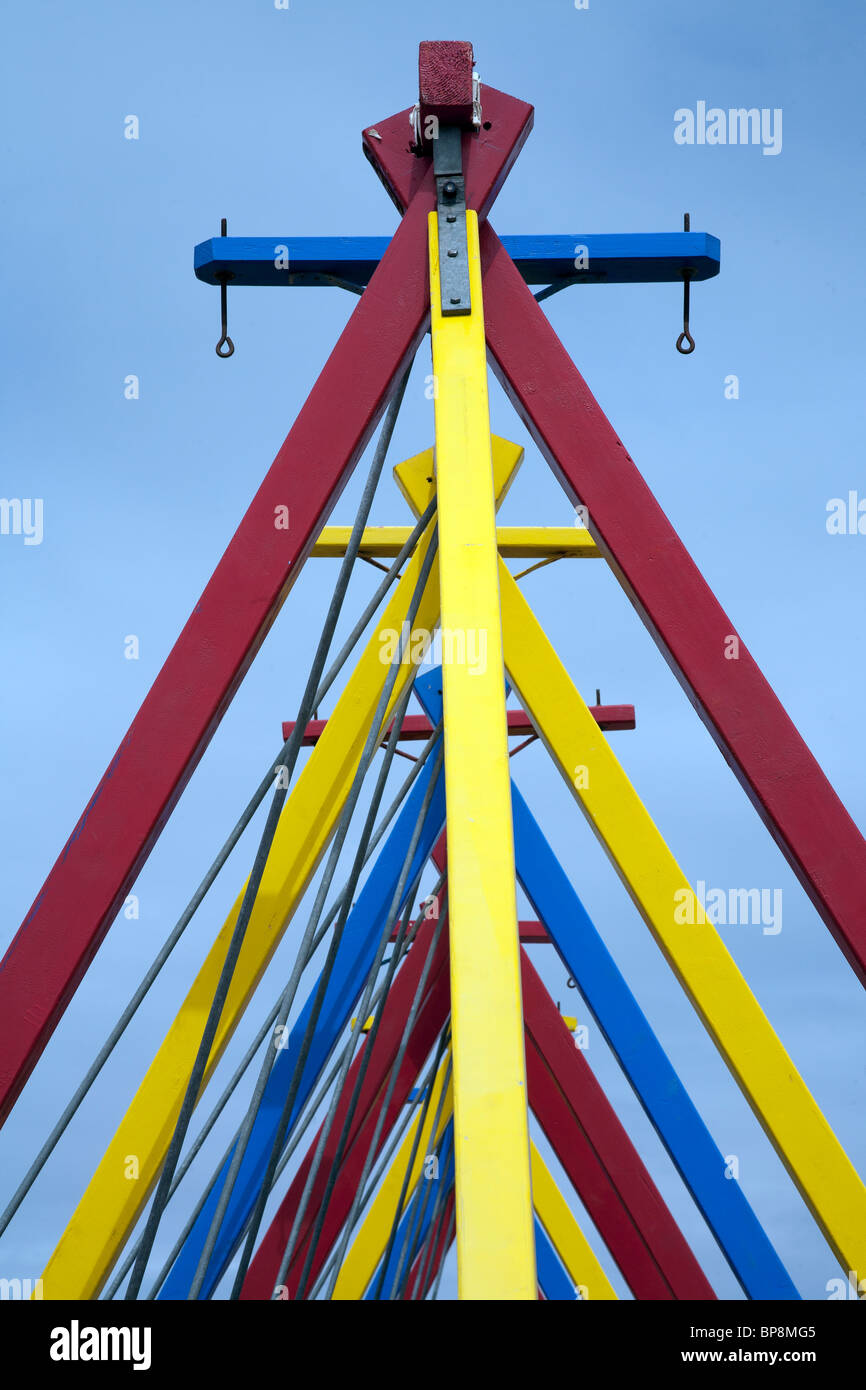 Colourful wooden poles supporting the swingboats at Weston Super Mare, Somerset UK - Stock Image