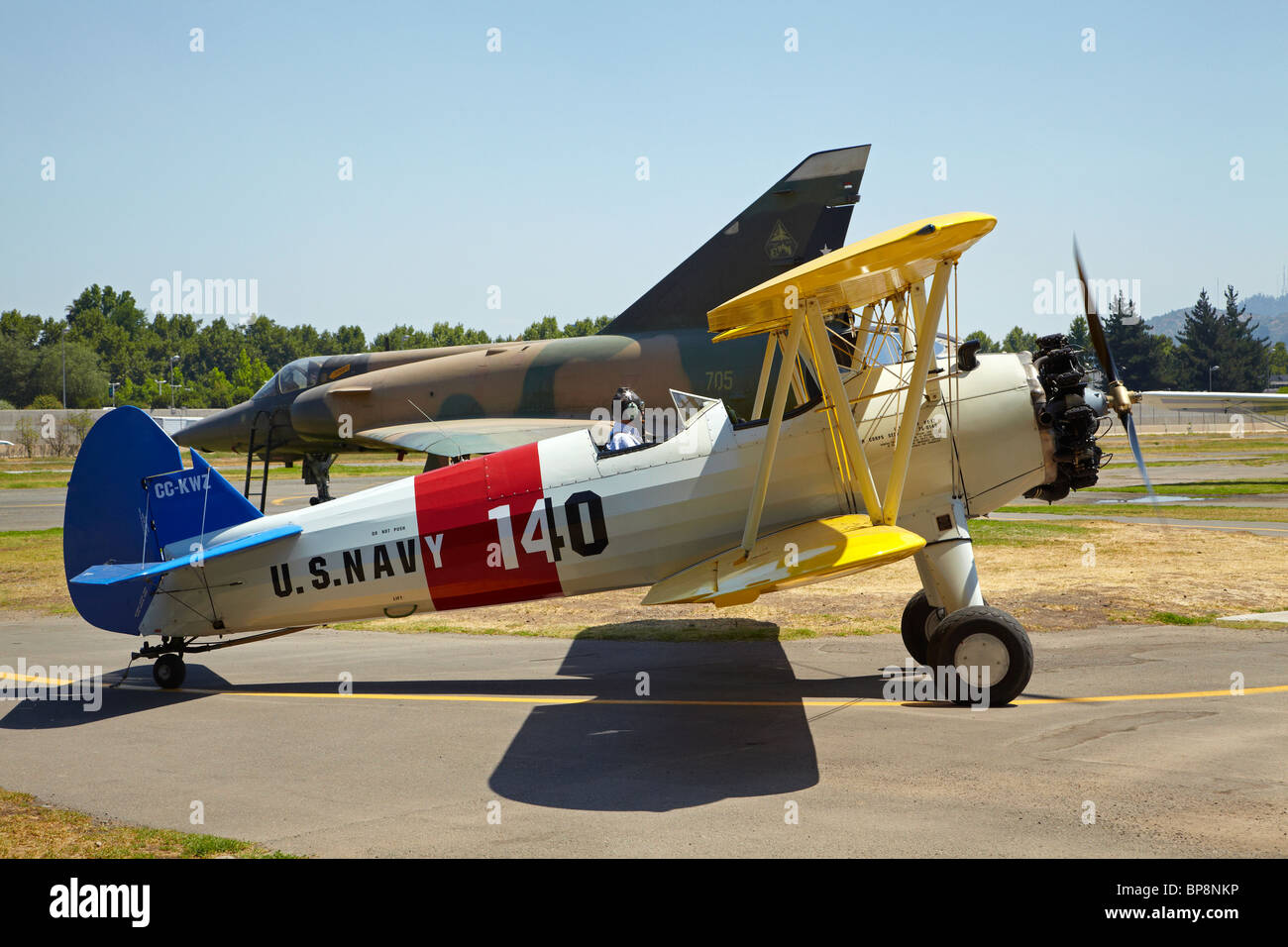 Boeing A75N1 Stearman Biplane, and MIG Fighter Jet, Vitacura Airfield, Santiago, Chile, South America - Stock Image