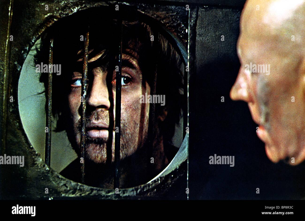 ALAN BATES THE FIXER (1968) - Stock Image