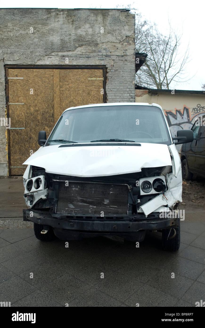 Damaged van parked Berlin Germany - Stock Image