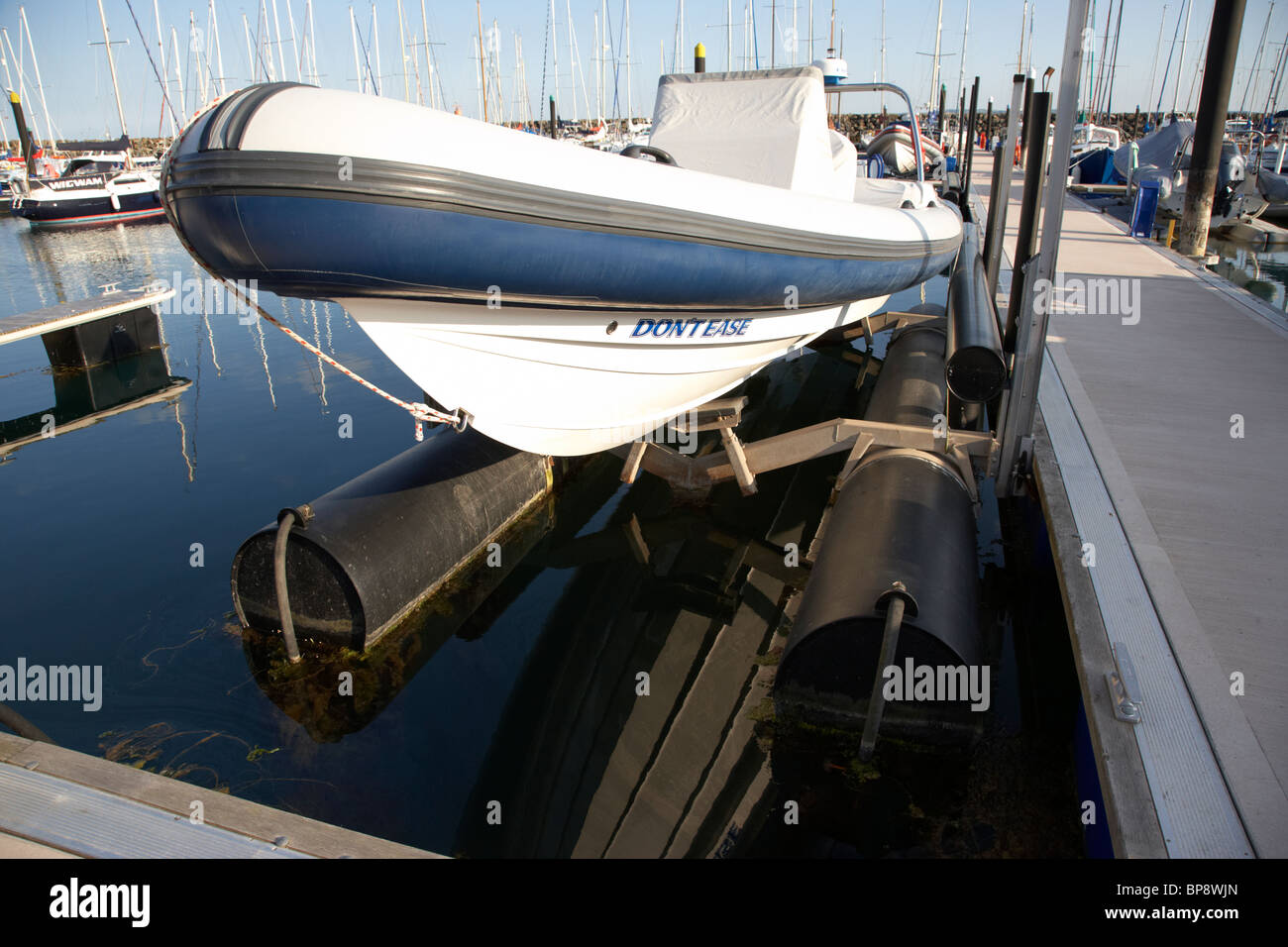 Inflatable Rib Boat On Hydraulic Boat Lift Next To A