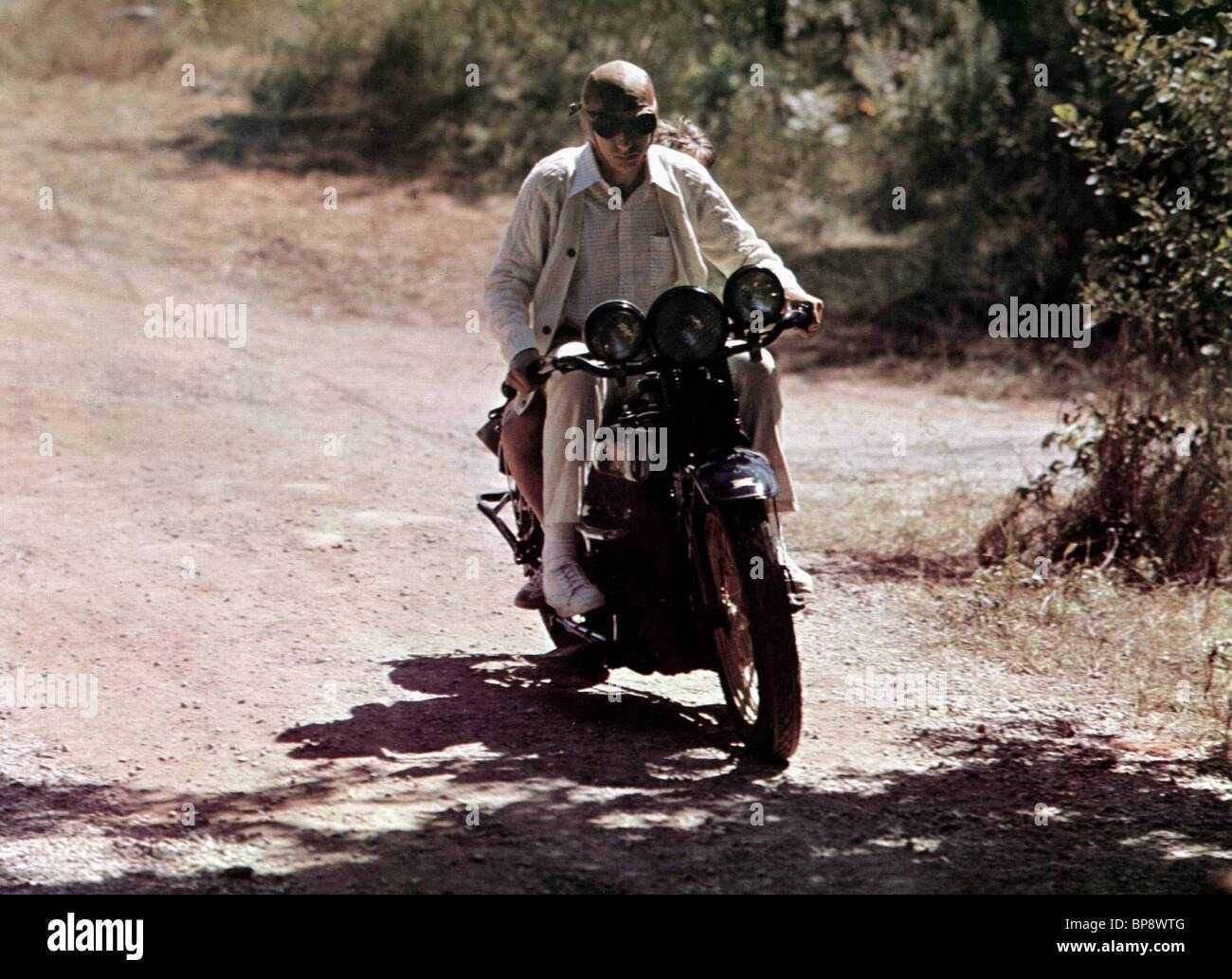 MOTORCYCLE AGE OF INNOCENCE (1977) - Stock Image