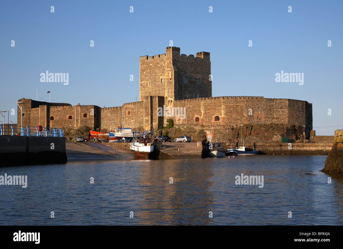 carrickfergus castle viewed from the harbour county antrim northern ireland uk - Stock Image