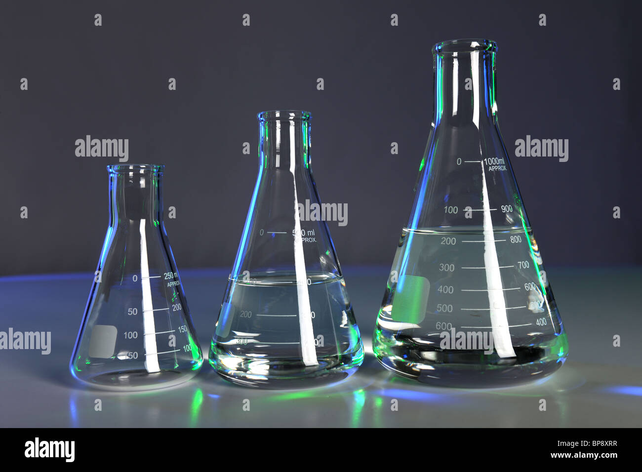 Flasks with fluid in laboratory setting - Stock Image