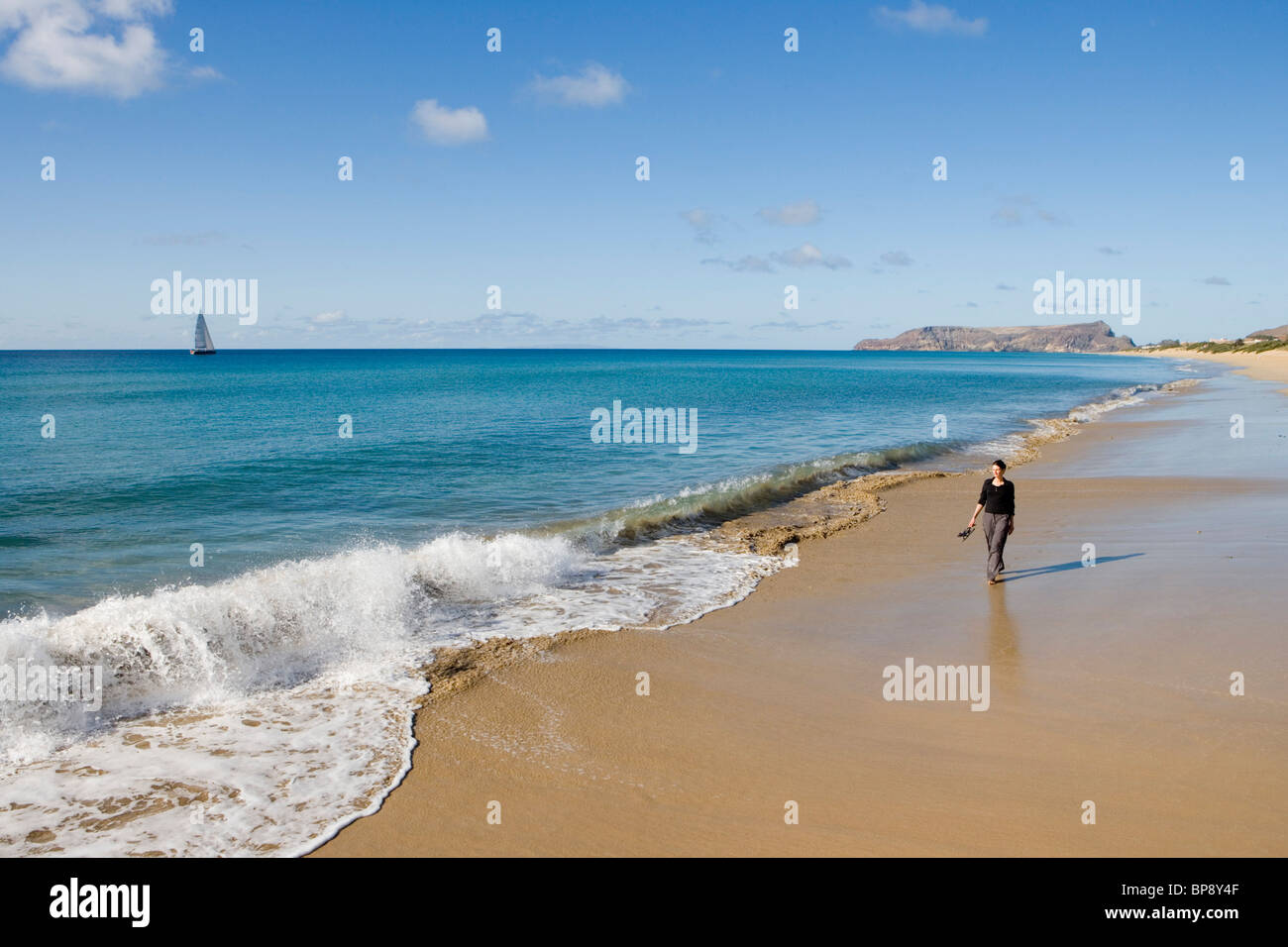 Woman strolling along Porto Santo Beach, Porto Santo, near Madeira, Portugal Stock Photo