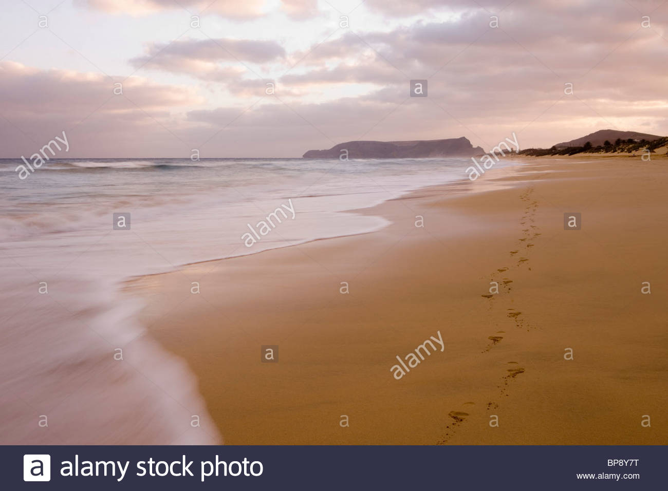 Footprints on Porto Santo Beach at Sunset, Vila Baleira, Porto Santo, near Madeira, Portugal - Stock Image