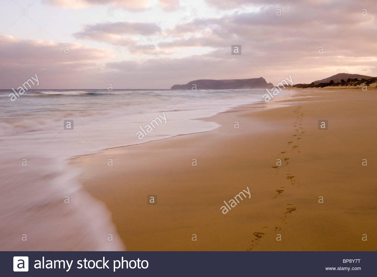 Footprints on Porto Santo Beach at Sunset, Vila Baleira, Porto Santo, near Madeira, Portugal Stock Photo