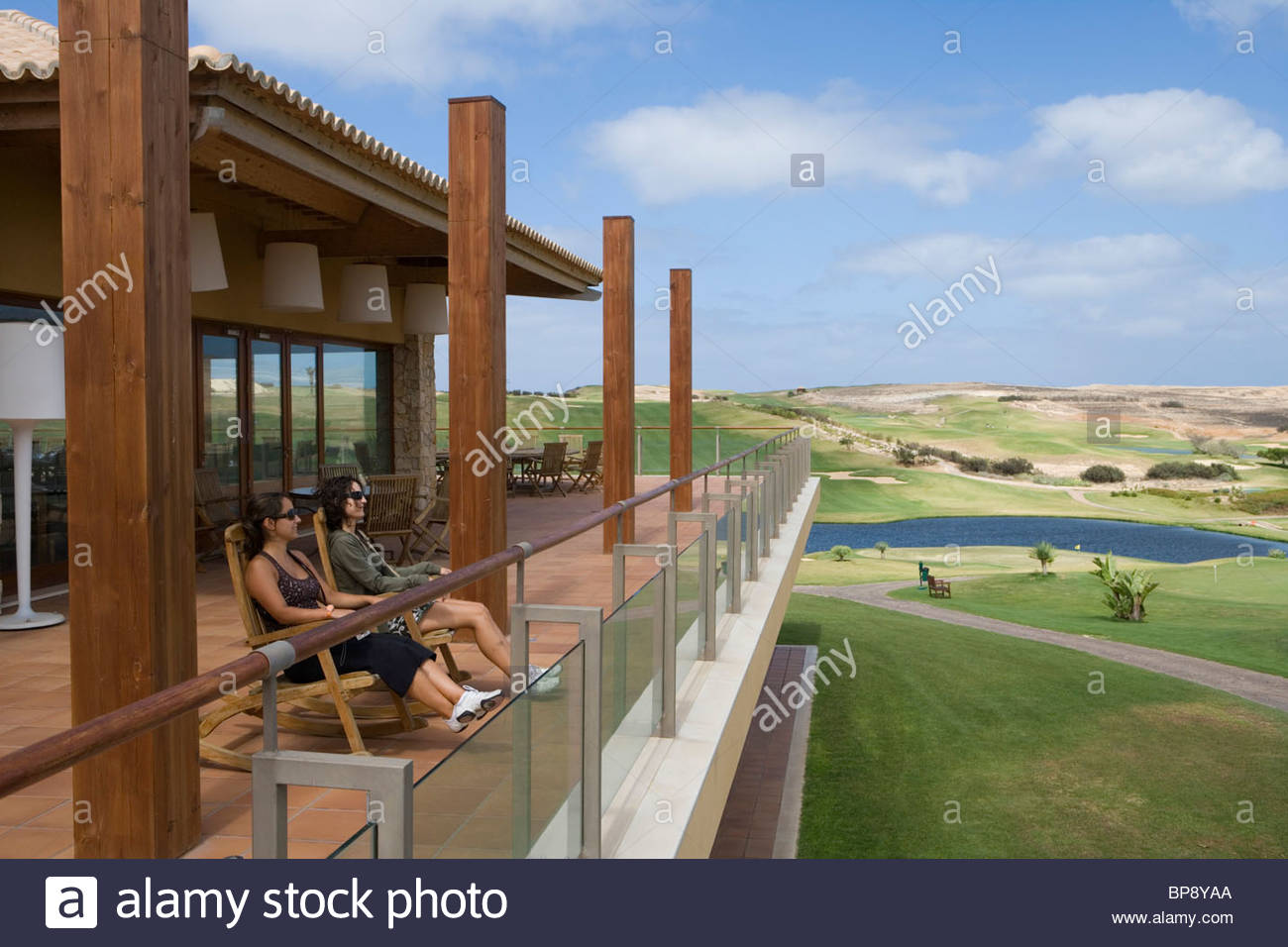 Two Women relaxing on the terrace of Porto Santo Golfe Golf Course Clubhouse, Porto Santo, near Madeira, Portugal - Stock Image