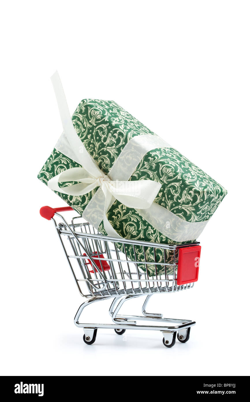 huge wrapped gift in shopping cart on white background - Stock Image