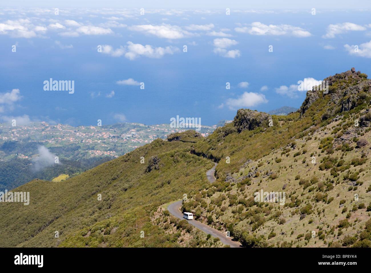 Bus on Road to Pico Ruivo with View of Santana, Achada do Teixeira, Madeira, Portugal - Stock Image