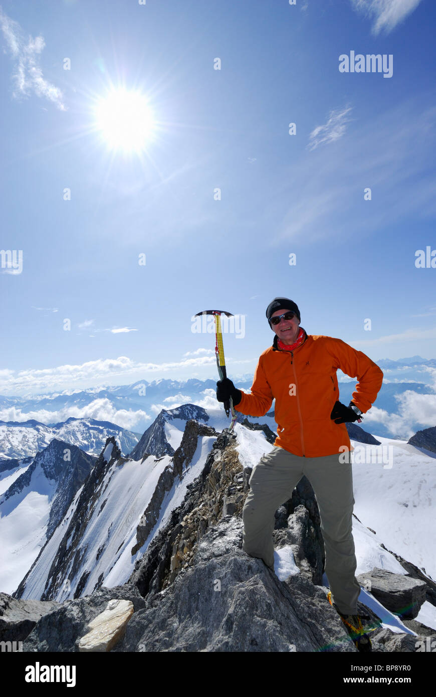 Mountaineer at Hochfeiler summit, Zillertal Alps, South Tyrol, Alto Adige, Italy Stock Photo