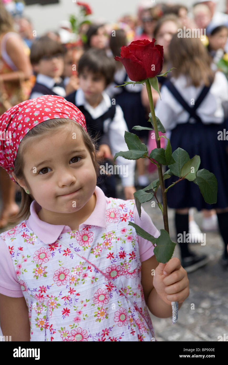 Girl Holding A Rose During The Childrens Parade At Madeira Flower Festival Funchal