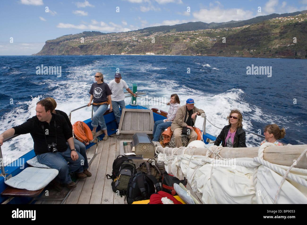 Aboard a whale watching boat Ribeira Brava, Near Calheta, Madeira, Portugal - Stock Image