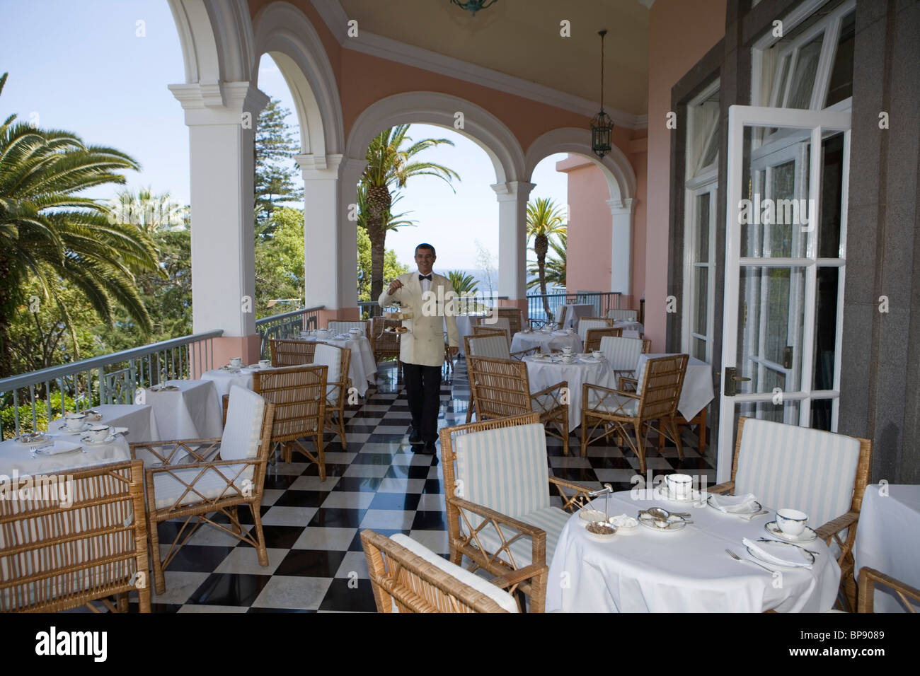 Waiter serves Afternoon Tea on the Terrace at Reid's Palace Hotel, Funchal, Madeira, Portugal - Stock Image
