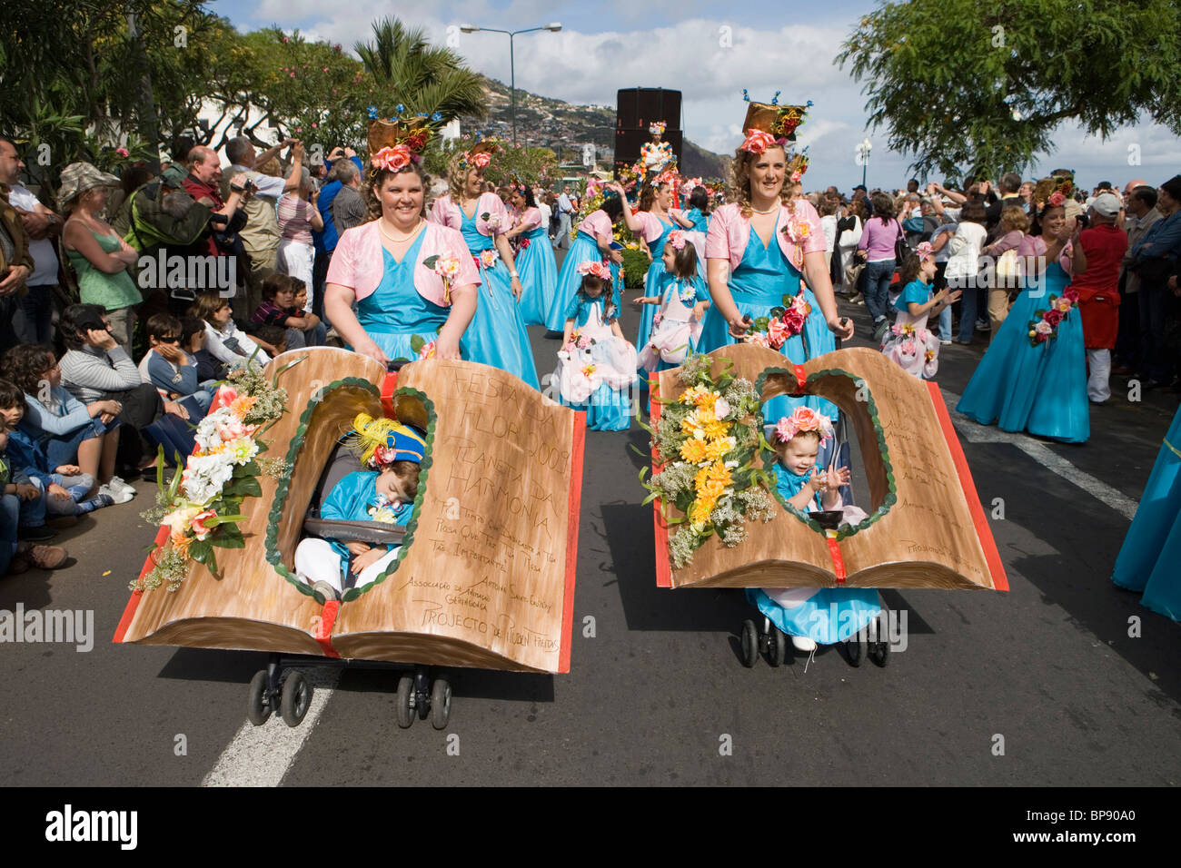 Mothers and children at the Madeira Flower Festival Parade, Funchal, Madeira, Portugal - Stock Image