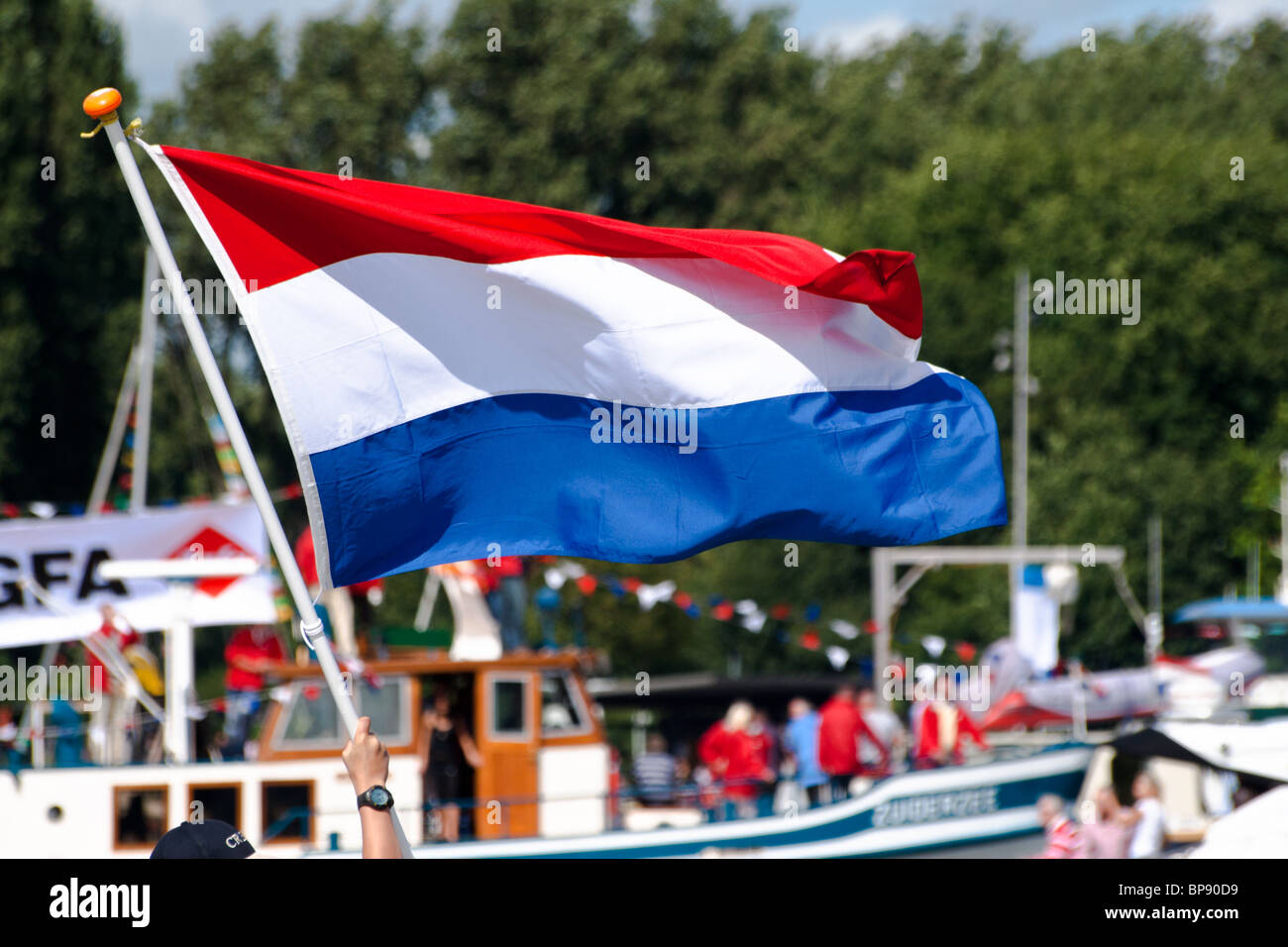 Dutch flag waved during SAIL Amsterdam 2010 - Stock Image