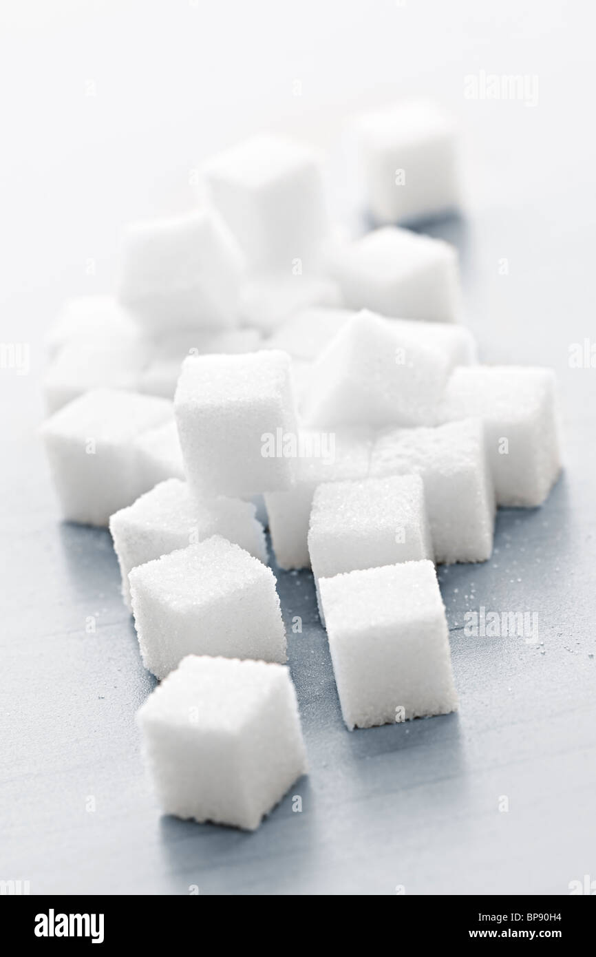 Close up of many white sugar cubes - Stock Image