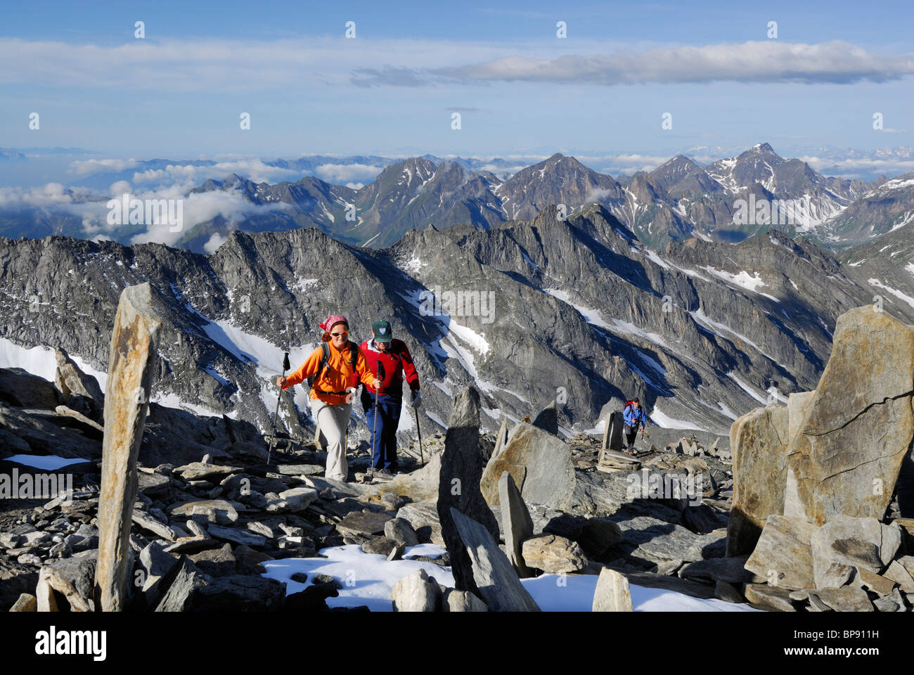 Three mountain hikers ascending to mount Hochfeiler, Zillertal Alps, South Tyrol, Italy Stock Photo