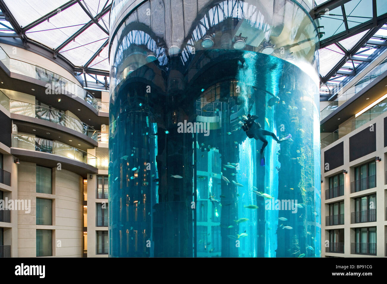 the 5 star Radisson SAS Hotel features the world's largest cylindrical aquarium. entrance to Aqua Dom, a diver - Stock Image