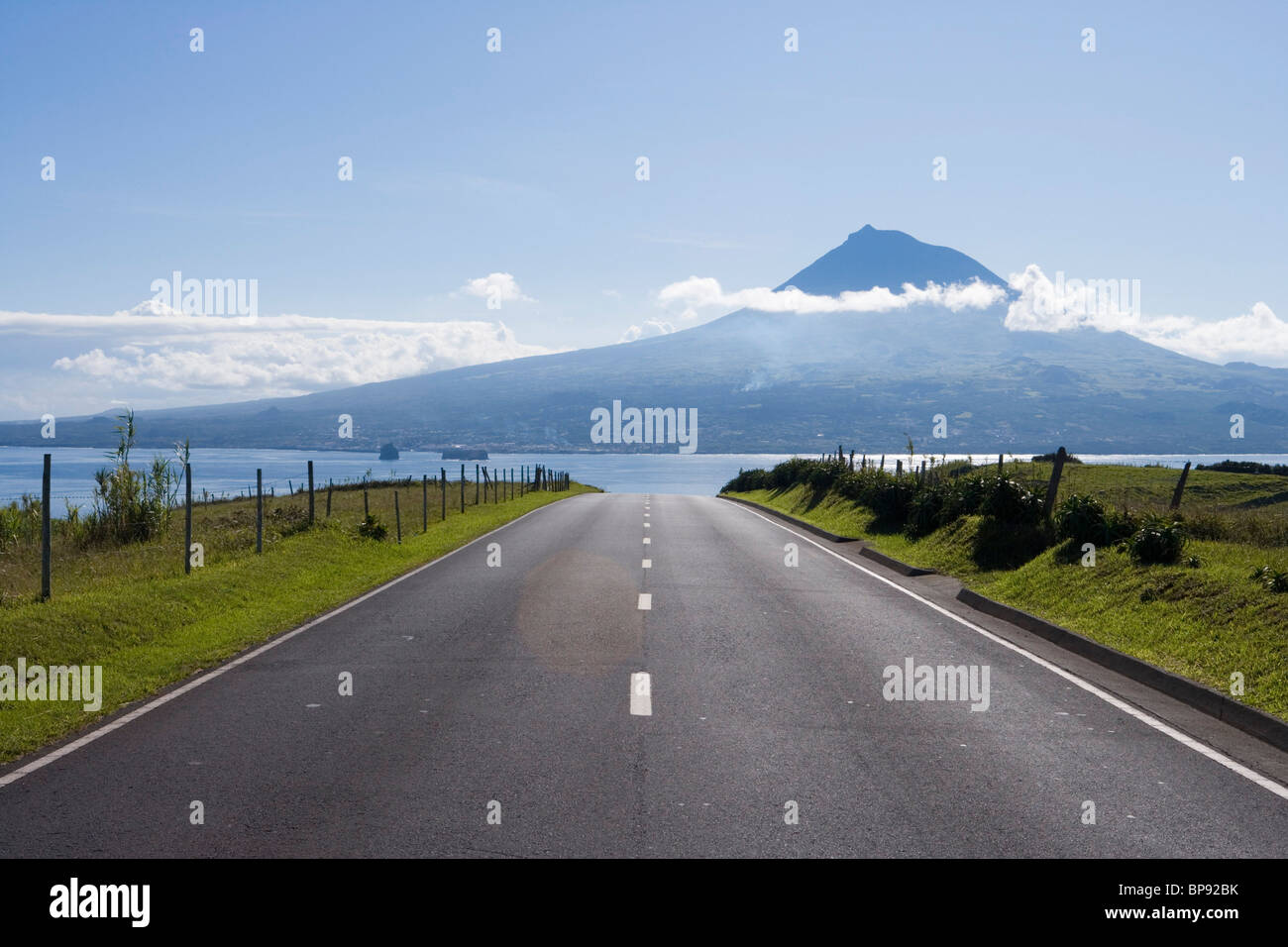 Road with view towards Pico Island, Horta, Faial Island, Azores, Portugal, Europe - Stock Image