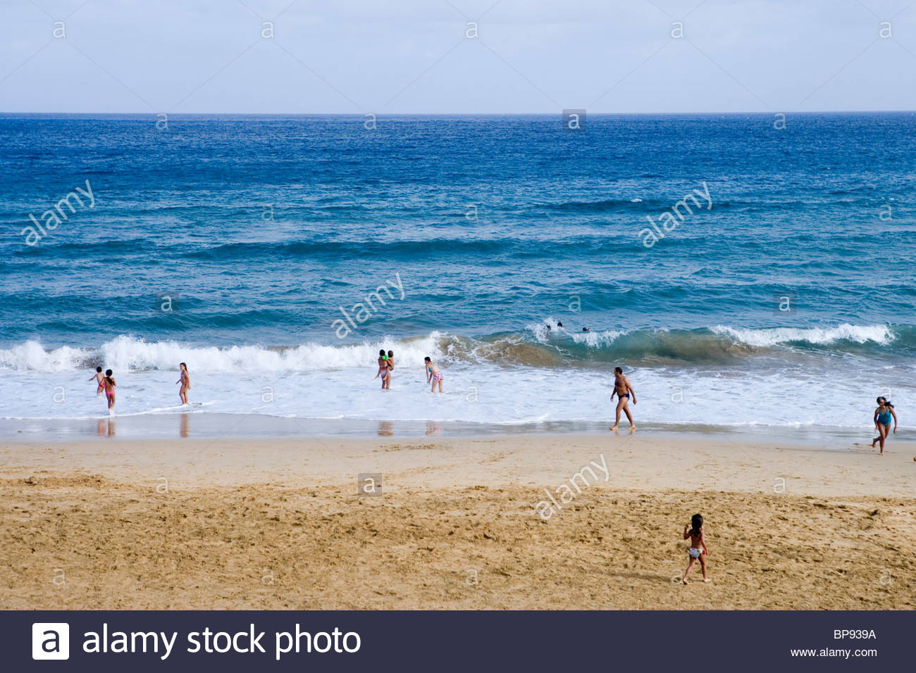 Children playing on Porto Santo Beach, Vila Baleira, Porto Santo, near Madeira, Portugal - Stock Image
