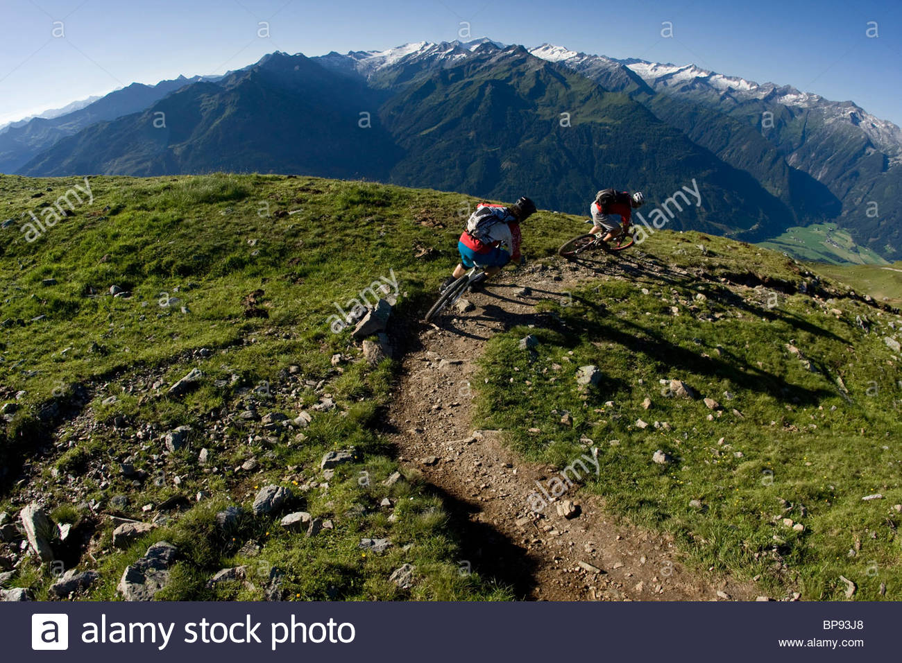 Two mountain bikers in mountain scenery, Neukirchen am Grossvenediger, Pinzgau, Salzburg state, Austria - Stock Image