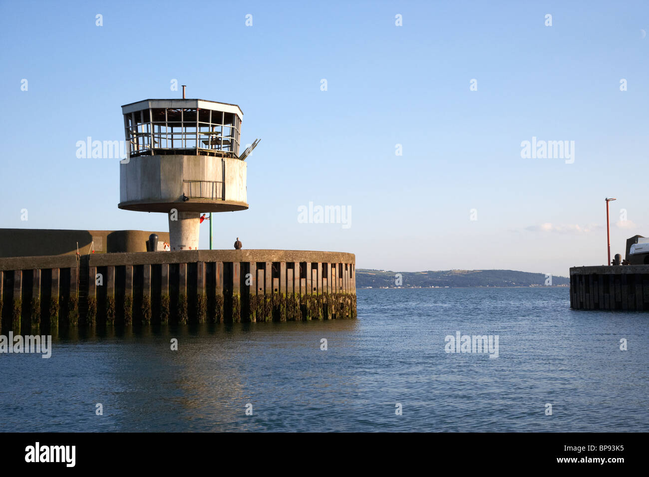former radio control tower at the entrance to carrickfergus harbour county antrim northern ireland uk - Stock Image