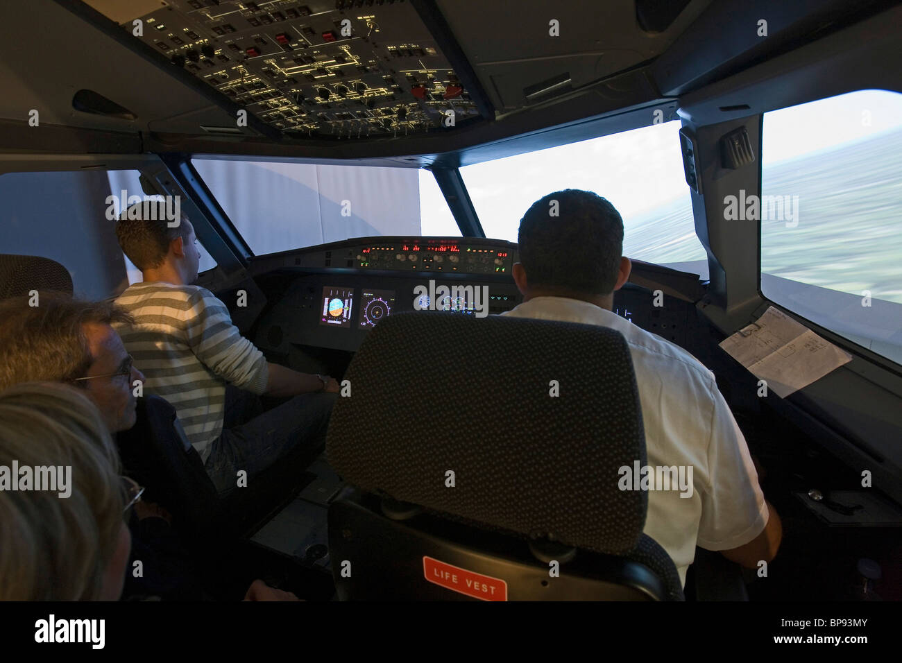 visitors in flight simulator, Welt der Luftfaht, World of Aviation, Hannover Airport, Lower Saxony, Germany - Stock Image