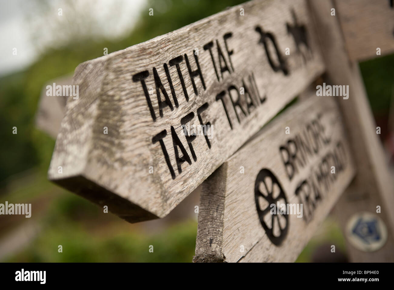Signpost for the Taff Trail on the Monmouthshire and Brecon Canal at Talybont on Usk, South Wales UK - Stock Image