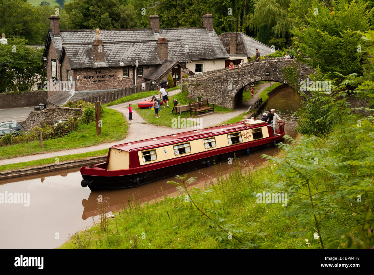 A narrowboat on the Monmouthshire and Brecon Canal by the White Hart Inn Talybont on Usk, South Wales UK - Stock Image