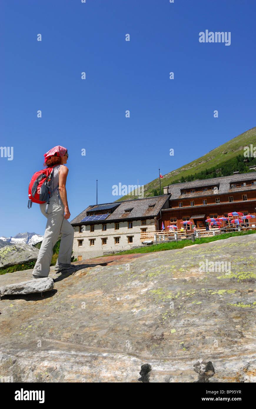 Female hiker near hut Berliner Huette, Zillertal, Zillertal Alps, Tyrol, Austria Stock Photo