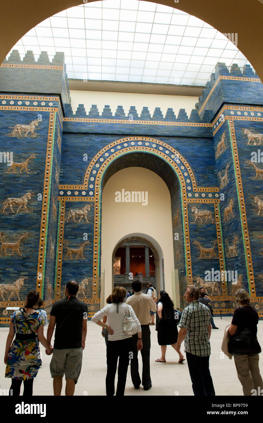 Visitors looking at Ishtar Gate from Babylon at Pergamon Museum in Berlin Germany Stock Photo