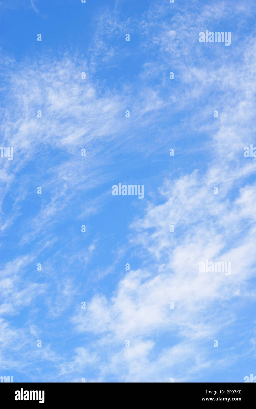 White Wispy Clouds in Evening Sky - Stock Image