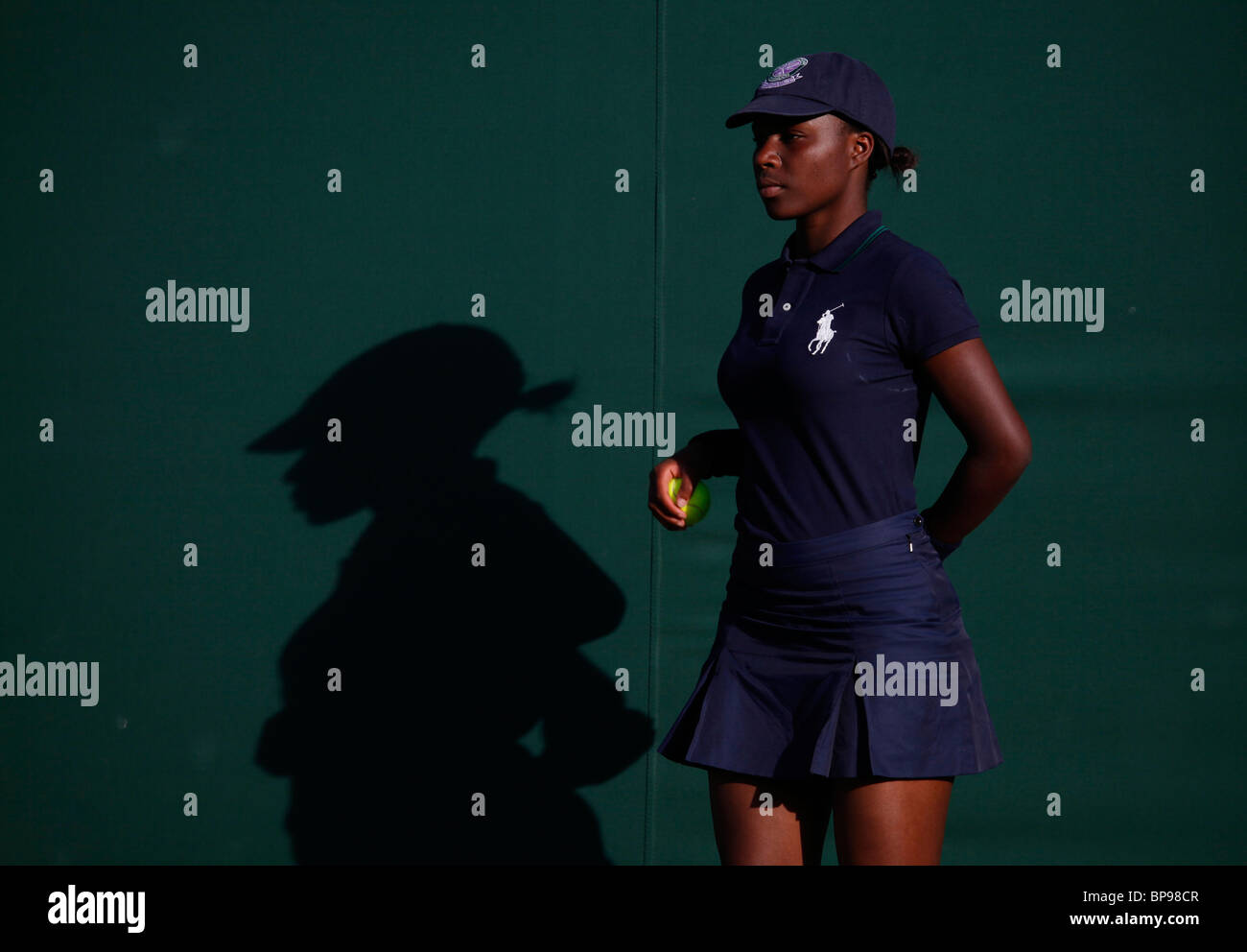 Ballgirl in the evening light of the 2010 Wimbledon Championships - Stock Image