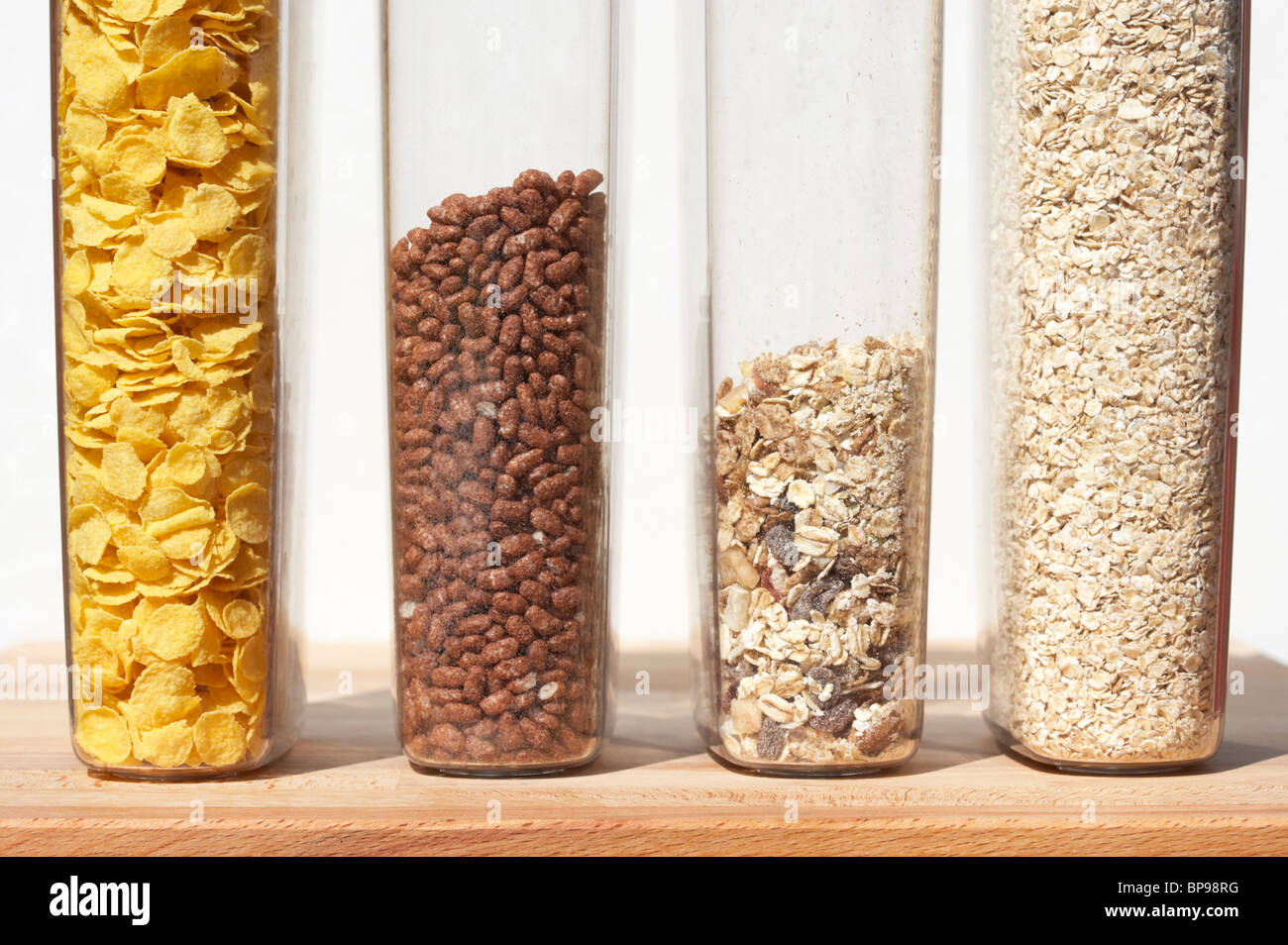 containers of different breakfast cereals including cornflakes coco pops chocolate rice muesli and oats - Stock Image