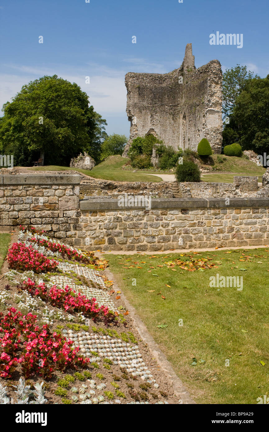 Grounds of Château de Domfront, with ruined castle in the background, Domfront, France - Stock Image