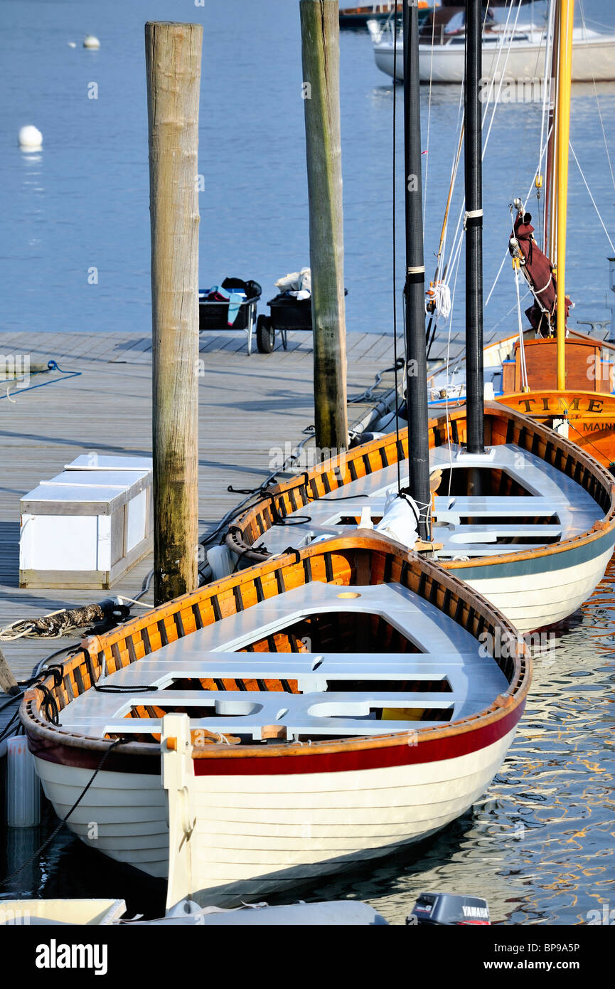 Tranquil scene white wooden boats tied to dock in Rockland Harbor Maine USA - Stock Image