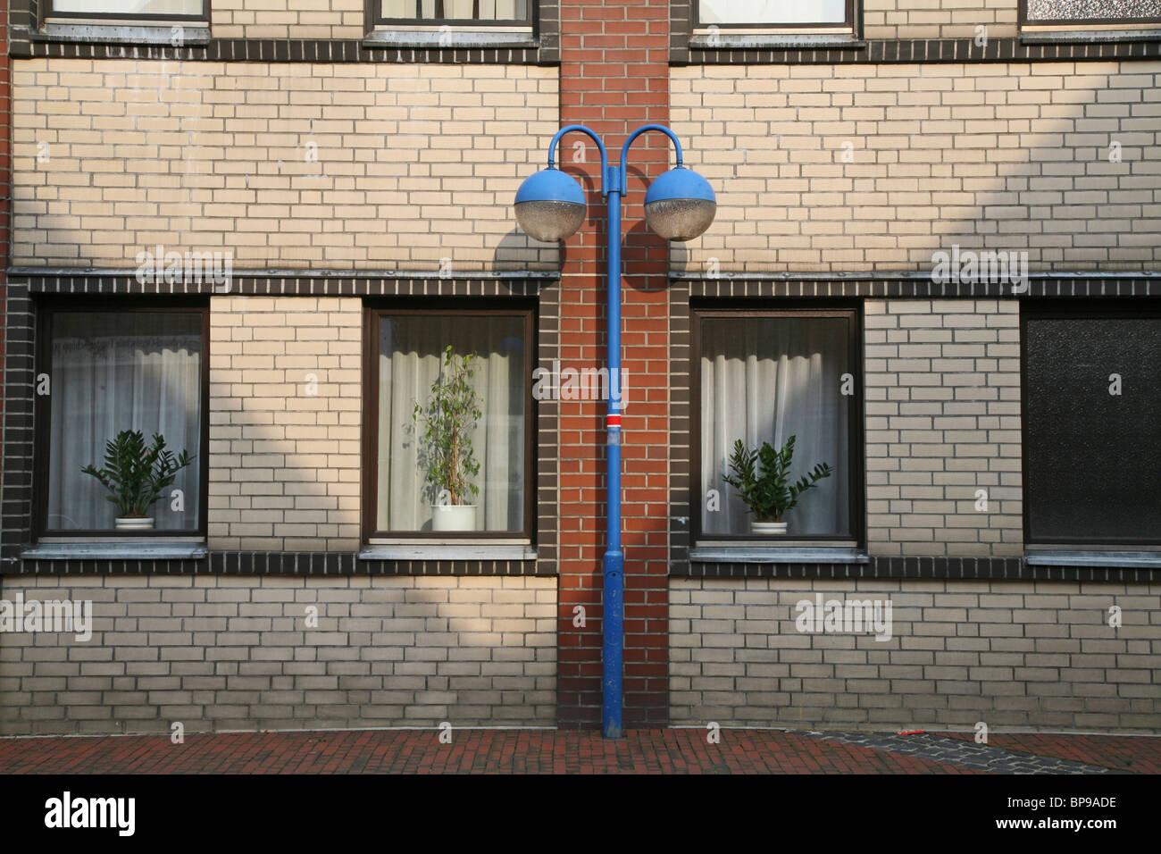 blue street lights, brick facade, northern Germany - Stock Image