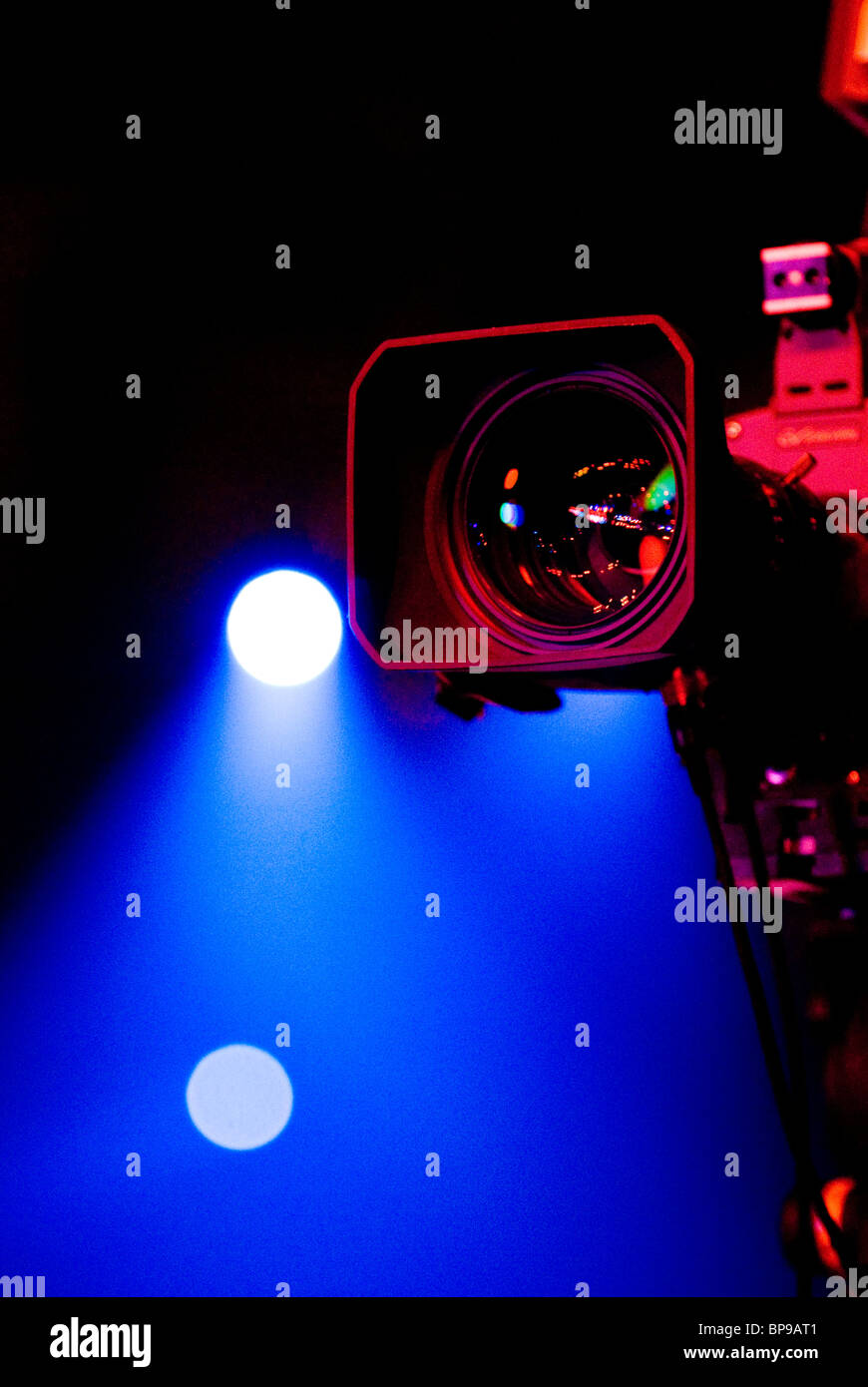 Video camera lens and stage lights - Stock Image