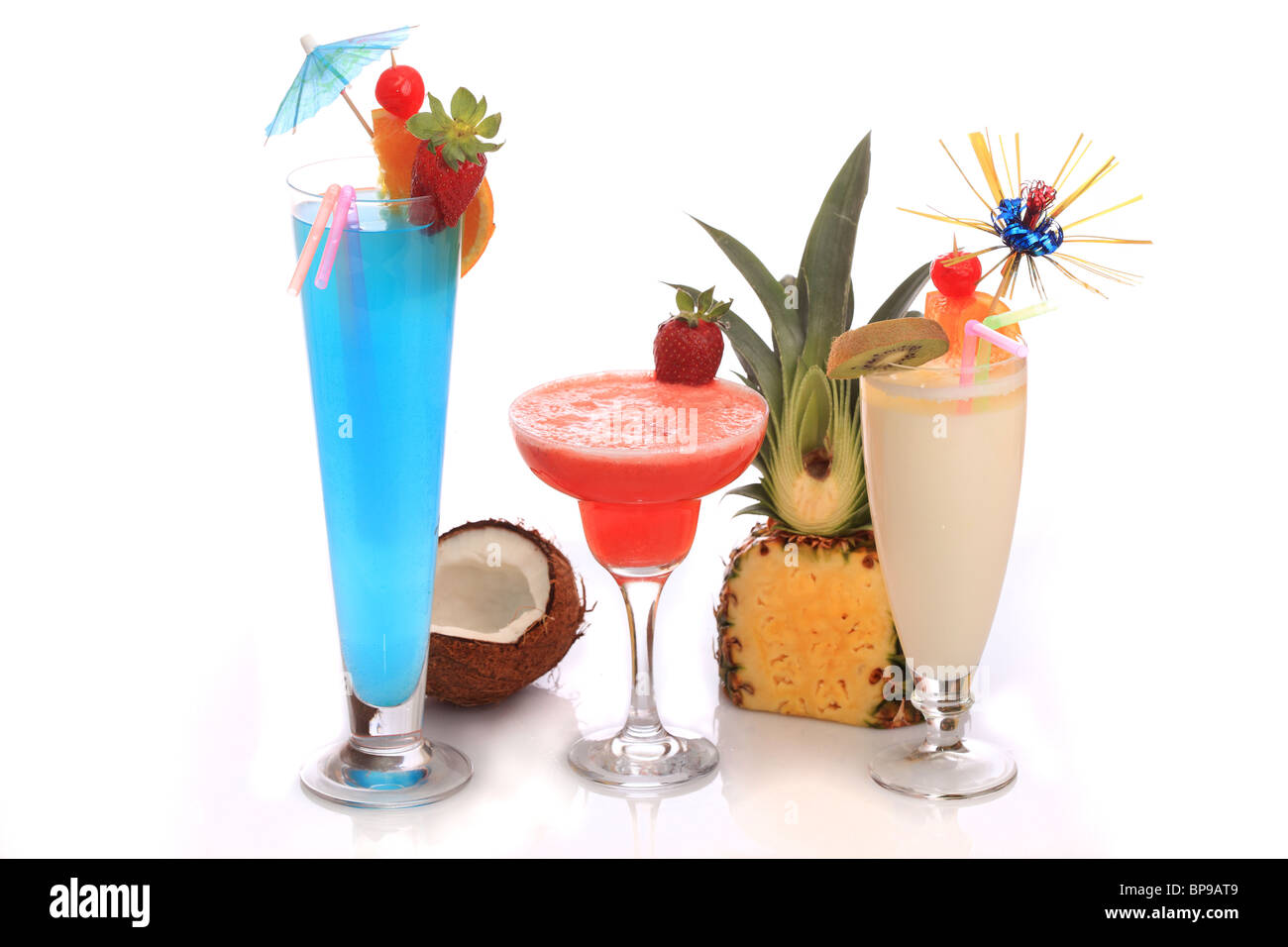 Decorated cocktails (Pina Colada, Strawberry Margarita and Blue Lagoon) over white background. - Stock Image