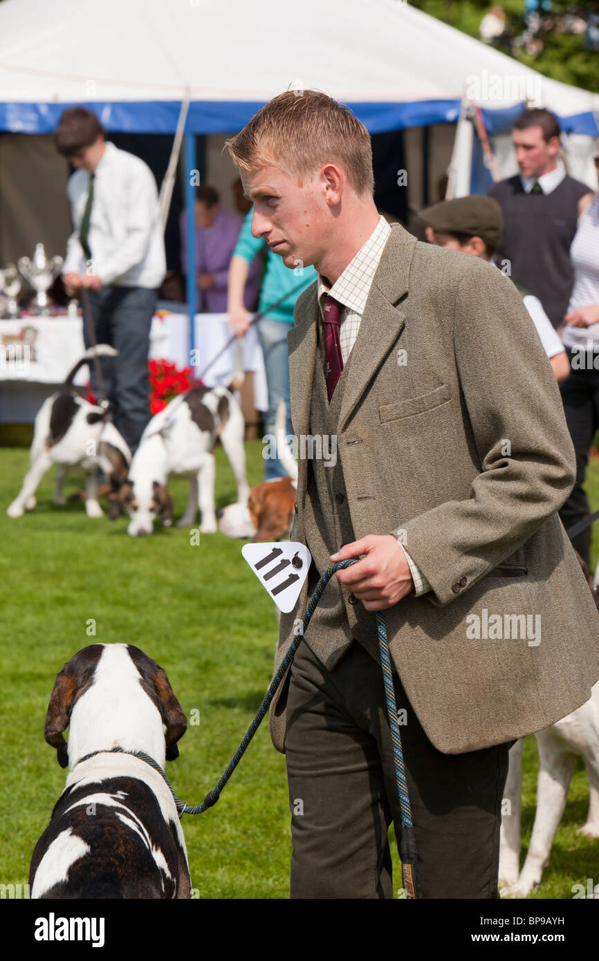 A Hunt supporter and his fox hound at the Vale of Rydal Sheepdog Trials, Ambleside, Lake District, UK. - Stock Image