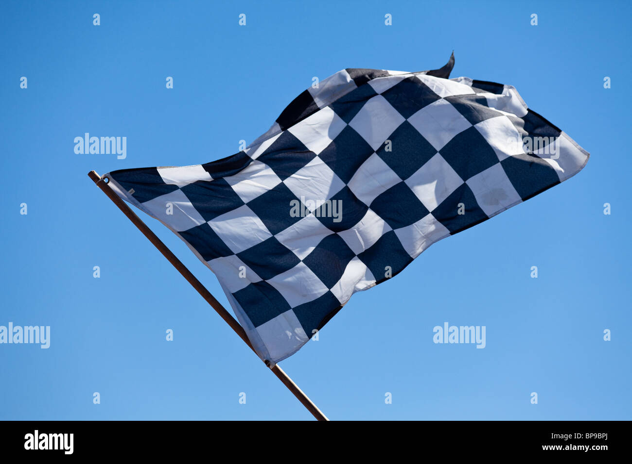 Checkered Flag and blue sky - Stock Image