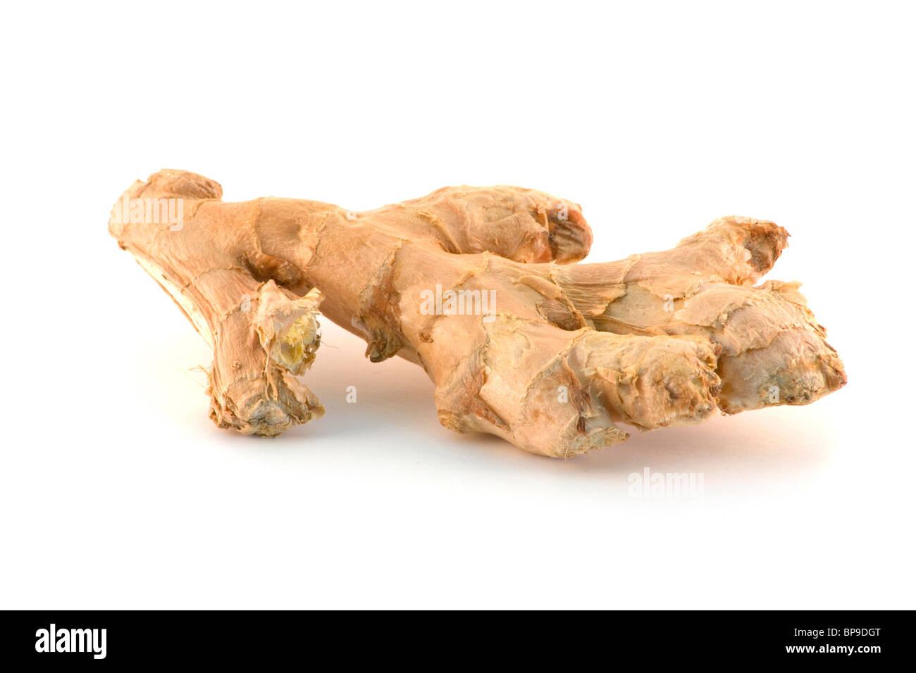 Fresh ginger root over white background - Stock Image