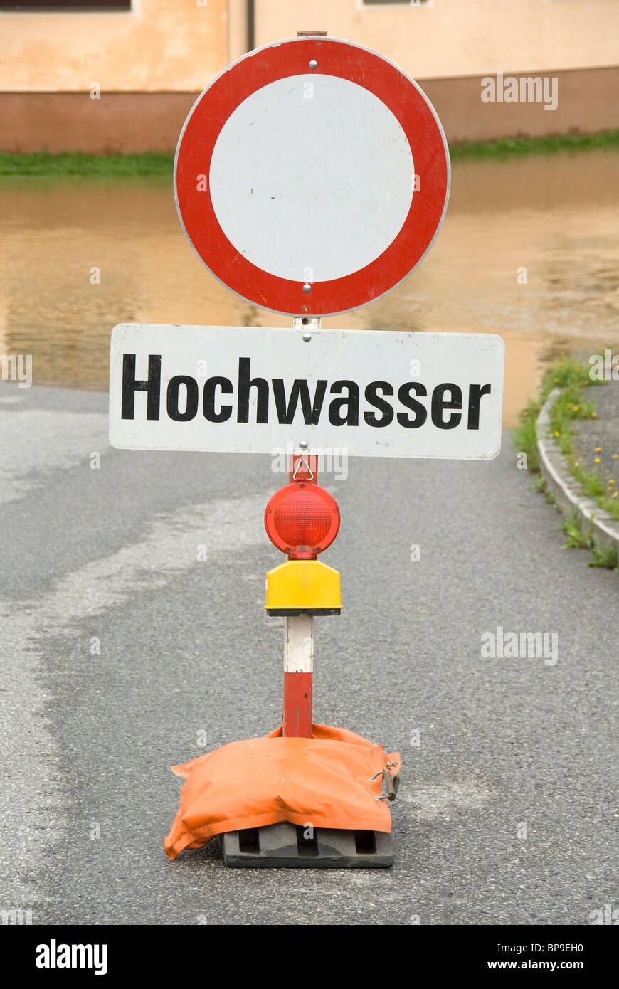 Flood sign in front of flooded road, Waldviertel, Lower Austria, Austria, Europe - Stock Image