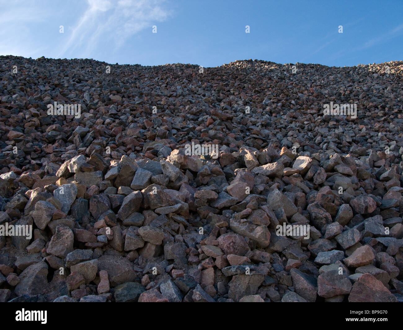 A pile of shattered stones from a mountain. - Stock Image