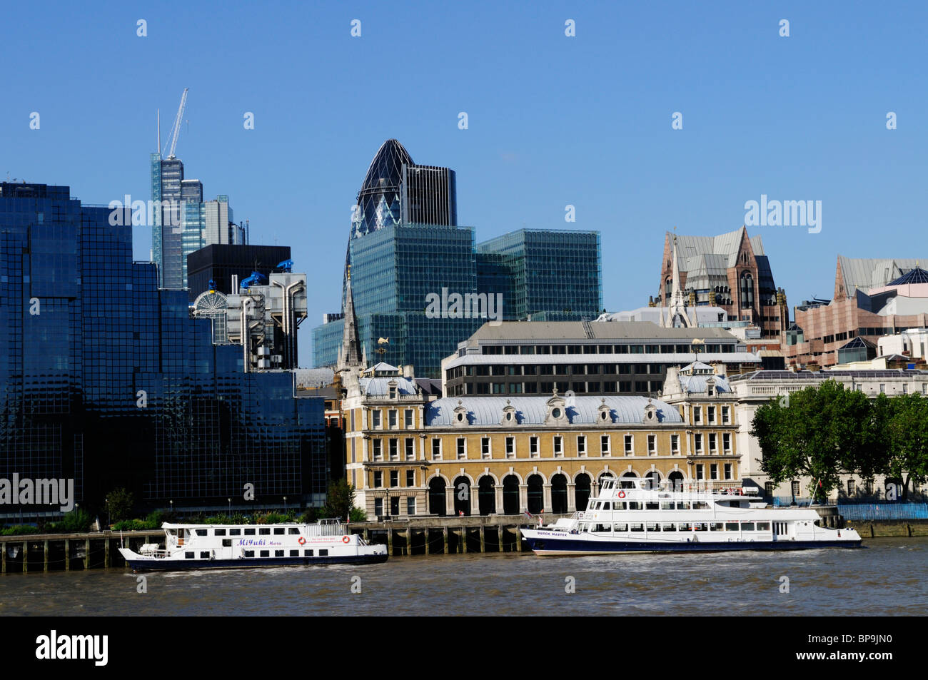 River Thames Cruise boats and city of London buildings, London, England, UK - Stock Image