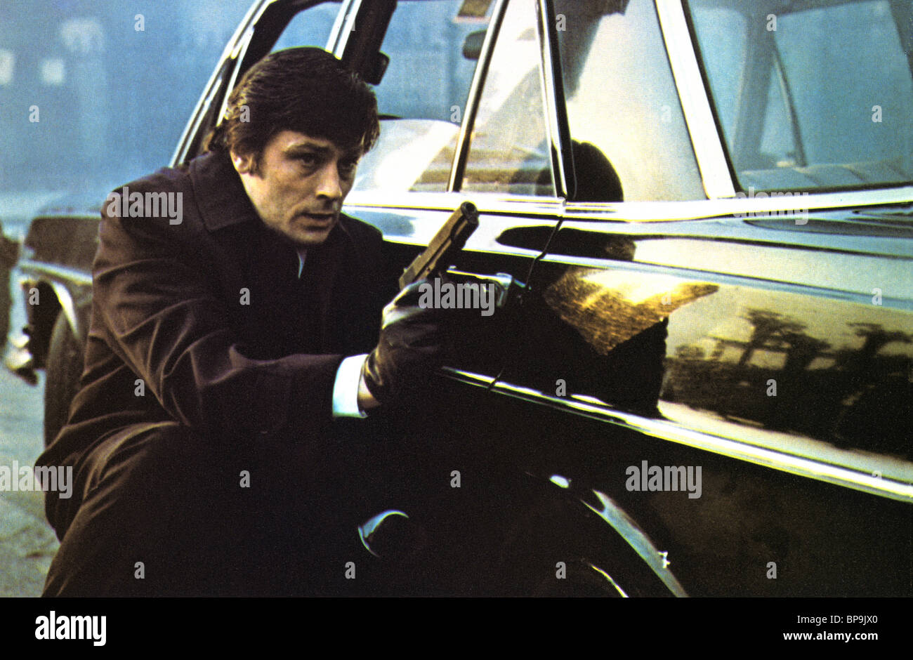 ALAIN DELON BIG GUNS (1973) - Stock Image