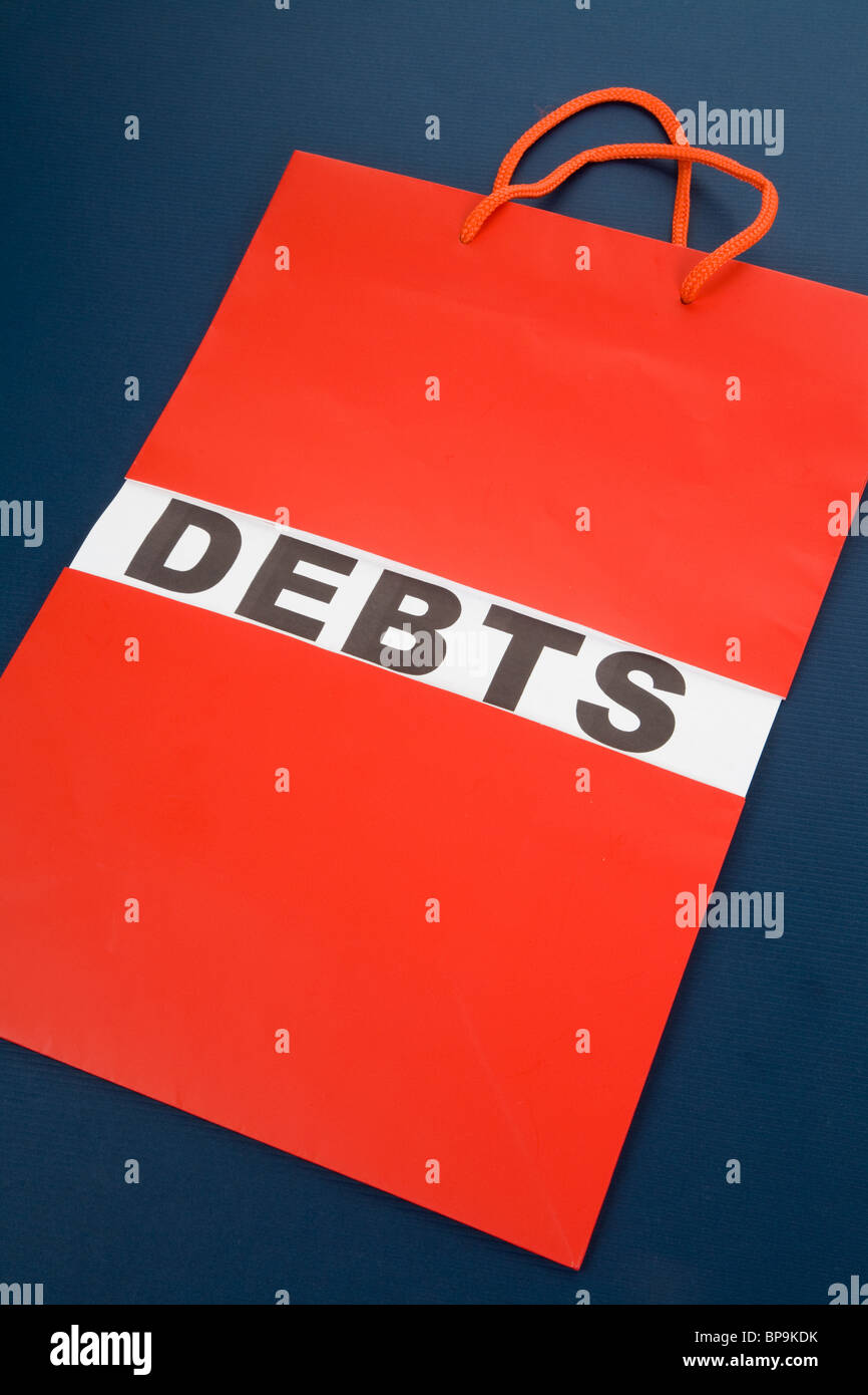 Shopping Bag and word debts concept of Financial difficulty - Stock Image