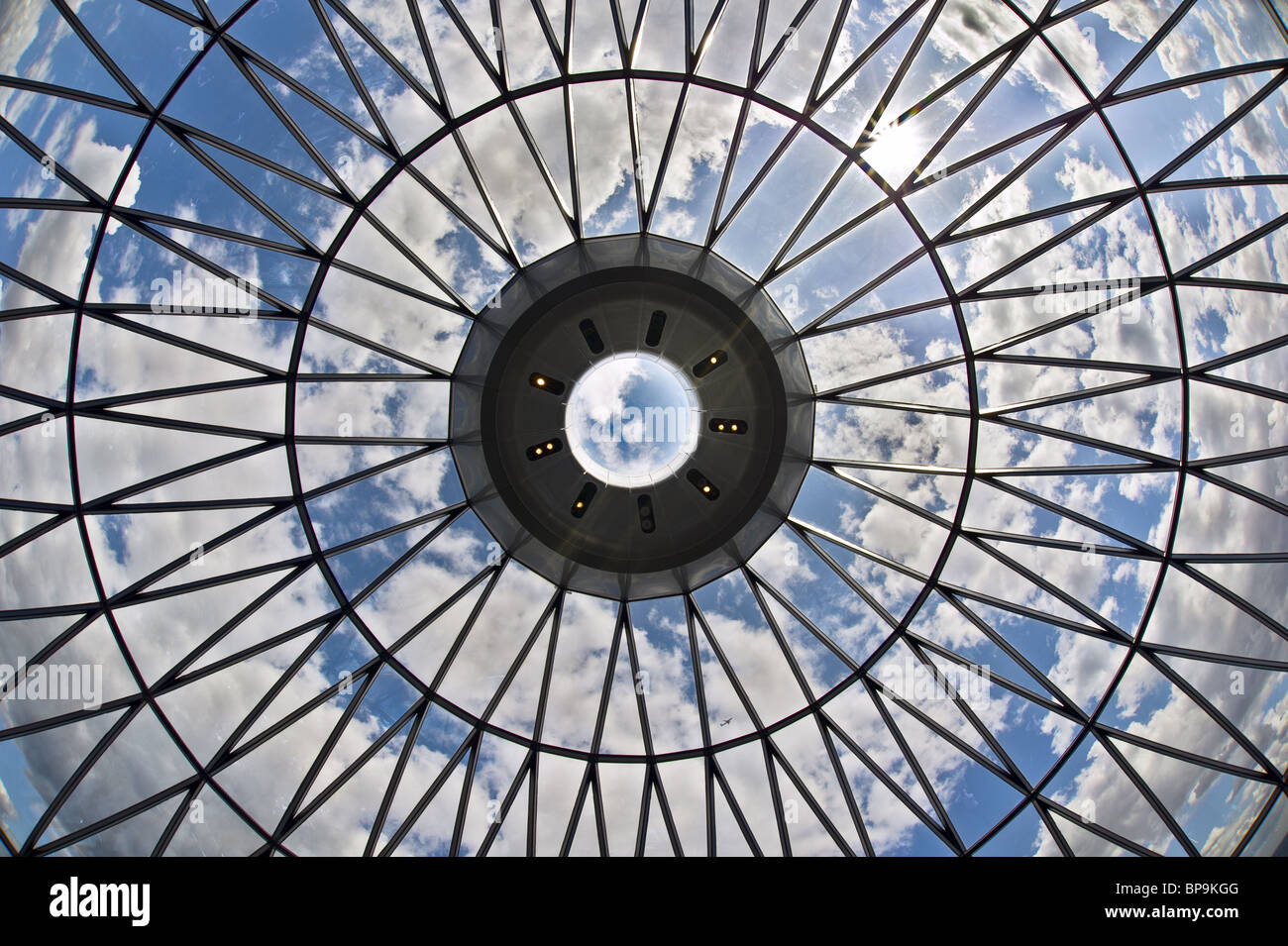 Looking at the sky through the dome of a skyscraper -- the proverbial glass ceiling? - Stock Image