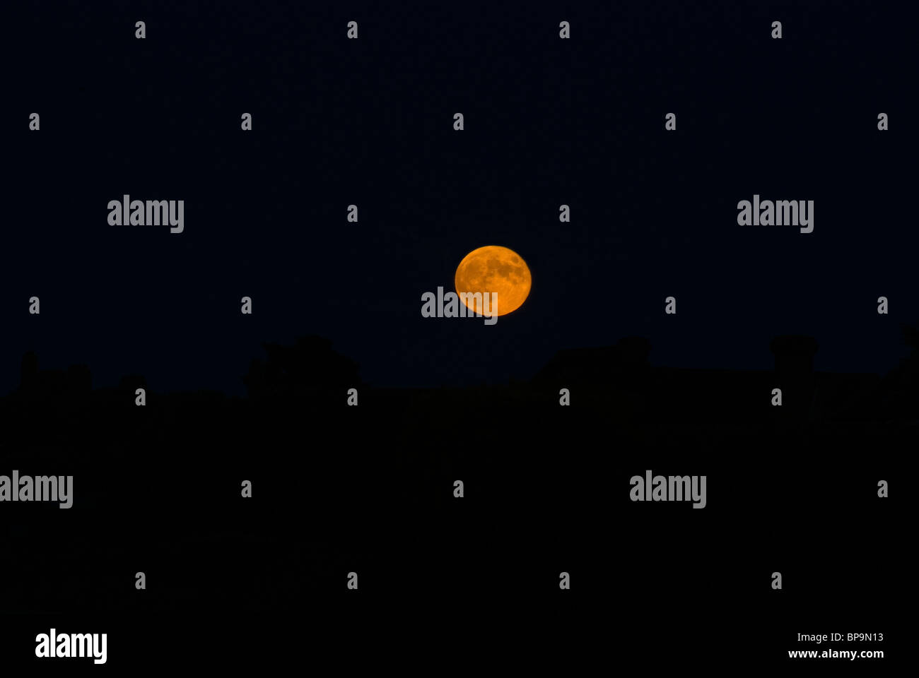 moon at sunset - Stock Image